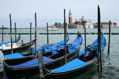 Gondolas in Venice. The gondola is a traditional, flat-bottomed Venetian rowing boat, well suited to the conditions of the Venetian Lagoon. For centuries Royalty Free Stock Images