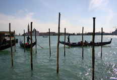 Gondolas in Venice. Image of gondolas and mooring poles in Venice, Italy Royalty Free Stock Photo