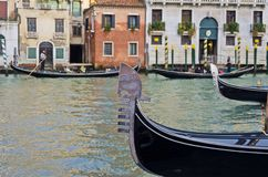 Gondolas in Venice. The bow of a gondola and behind other gondolas in one of the many water channels of Venice Stock Images