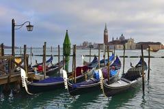 Gondole a Venezia sull`acqua. Gondolas in Venice with the Church of San Giorgio in the background stock image