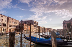 Gondolas in Venice. Gondolas on the Grand Canal , taken at sunset from beneath the Rialto bridge in Venice Stock Photos