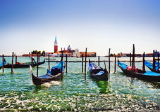 Gondolas in Venice, Italy. Gondolas with view of San Giorgio Maggiore island. Venice, Italy royalty free stock images