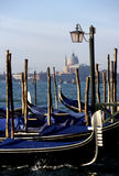 Gondolas- Venice, Italy. Gondolas on the Grand Canal at watefront of Piazza San Marco- Venice, Italy Royalty Free Stock Image