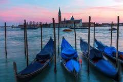 Gondolas in Venice, Italy, at dusk Royalty Free Stock Image