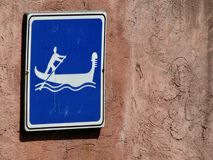 The gondolas of Venice, Italy have signs which warn people they are coming Stock Photos