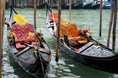 Gondolas in Venice, Italy. Waiting for tourists to come for a traditioal boat ride on the Canal royalty free stock photo
