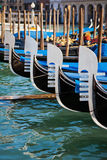 Gondolas in Venice in a row Stock Photography