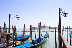 Gondolas in Venice with view over canal Stock Photos