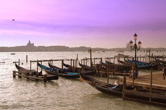 Gondolas in Venice wharf. Moored gondolas waiting for passengers at wharf on sunset.Picture taken on February 8th,2015,Venice,Italy Stock Image