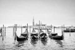 Gondolas with view of San Giorgio Maggiore bw Stock Photos