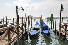 Gondolas and view San Giorgio Maggiore in Venice Stock Photos