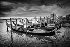 Gondolas with view of Santa Maria della Salute at sunset bw Royalty Free Stock Photography