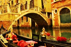 Gondolas in vintage hues, Venice, Italy. Golden and black decorations details of gondolas and famous bridges in Venice in vintage hues, Italy, Europe Stock Image
