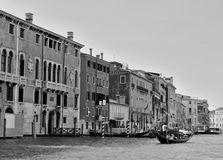 Gondolas on water street in Venice in black and white Stock Photography