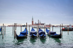 Gondolas in water with view of San Giorgio Maggiore Stock Image