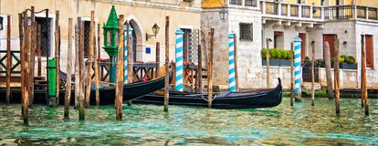 Gondolas and wooden piles on the grand Canal, panorama of Venice Italy stock photo