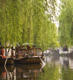 Gondolas in Zhouzhuang China. Some gondolas and weeping willows in the resort town of Zhouzhuang in Jiangsu Province, China Stock Photo