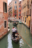 Gondole in a canal of Venice.  stock image