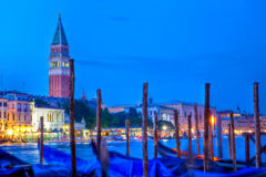 Gondole in front of San Marco, Venice. Gondole in front of the Campanile of the basilica of San Marco, Venice at night stock image