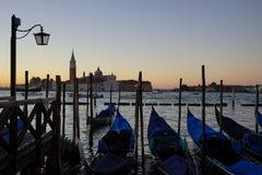 Gondole Stazio Danieliin on sunrise, with Church of San Giorgio Maggiore on the background. Venice, Italy royalty free stock images