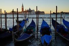 Gondole Stazio Danieliin on sunrise, with Church of San Giorgio Maggiore on the background. Venice, Italy royalty free stock photos