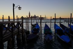 Gondole Stazio Danieliin on sunrise, with Church of San Giorgio Maggiore on the background. Venice, Italy stock images