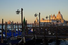 Gondole Stazio Danieliin on sunrise, with multiple moored and covered gondolas in the foreground. Venice, Italy stock photos