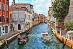 Gondoler på en Venetian kanal Fotografering för Bildbyråer