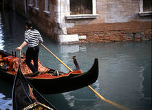 Gondolier. THis gondolier maneuvers his way through the tiny canals of Venice, Italy royalty free stock images