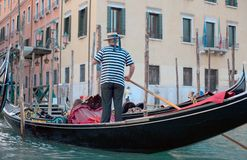 Gondolier. A gondolier works on a warm summer day in Venice Royalty Free Stock Photos