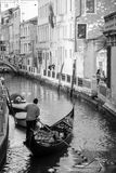 Gondolier. Has moving from the canal to be his Gondola in Venice Royalty Free Stock Images