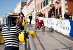 Gondolier applauds a disabled athlete Royalty Free Stock Photography