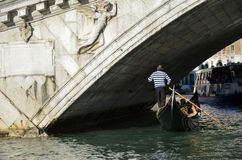 Gondolier with a blue stripped shirt royalty free stock image