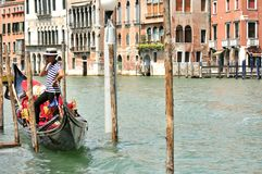Gondolier with the boat in Venice , Italy Stock Photo