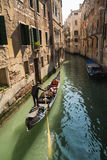 Gondolier on canal in Venice Royalty Free Stock Images