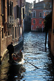 Gondolier in the channel in Venice Stock Photography