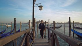 Gondolier and Customer on the Grand Canal in Venice stock video footage