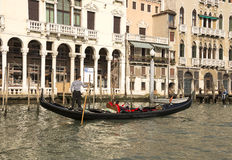 The gondolier floats on a gondola with tourists Royalty Free Stock Image