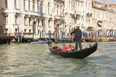 The gondolier floats on a gondola with tourists Stock Photo