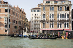 The gondolier floats on a gondola with tourists Stock Photography