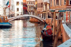 Gondolier floats on the narrow channel in Venice, Italy. Gondolier floats on the narrow channel Stock Photography