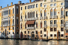 Gondolier floats past the old palazzo in Venice Stock Photography