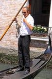 Gondolier in a gondola Stock Photography