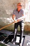 Gondolier in a gondola Stock Image