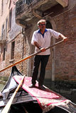 Gondolier in a gondola Stock Photography