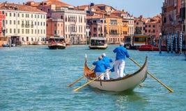 Gondolier gondola on Grand canal Venice italy Stock Images