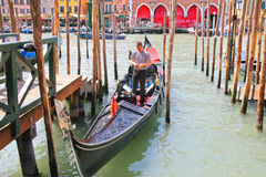 Gondolier in a gondola on the Grand Canal in Venice, Italy Stock Photo