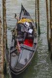 Gondolier and gondola at the pier. stock photo