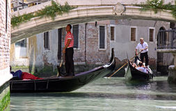 Gondolier, gondola and tourists in Venice Royalty Free Stock Photo