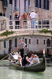 Gondolier, gondola and tourists in Venice Royalty Free Stock Images